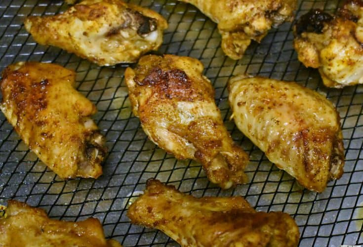 super easy crispy baked buffalo chicken wings! Crispy and just as good as fried, but so much healthier! great game day/ party food!