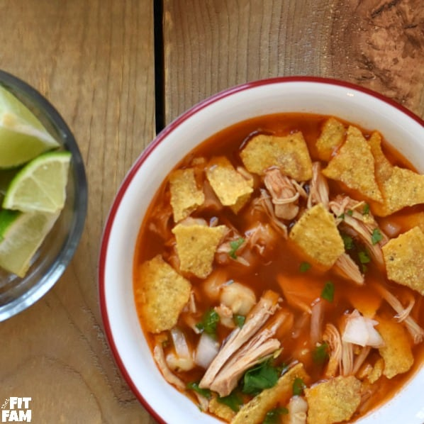 Easy Mexican Pozole Rojo, perfect comfort food. Made with chicken instead of pork. love the dried chili peppers in this! so yummy and surprisingly healthy! We love making this for Christmas dinner! #mexicanfood #pozole #soup #comfortfood