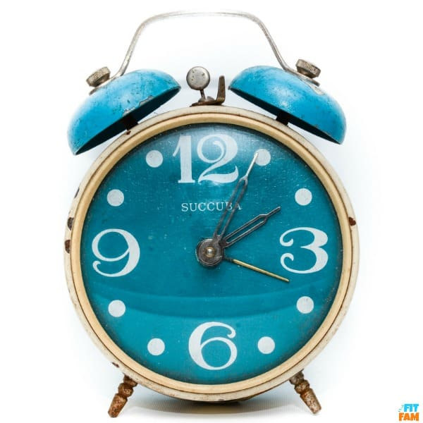 blue old fashioned alarm clock