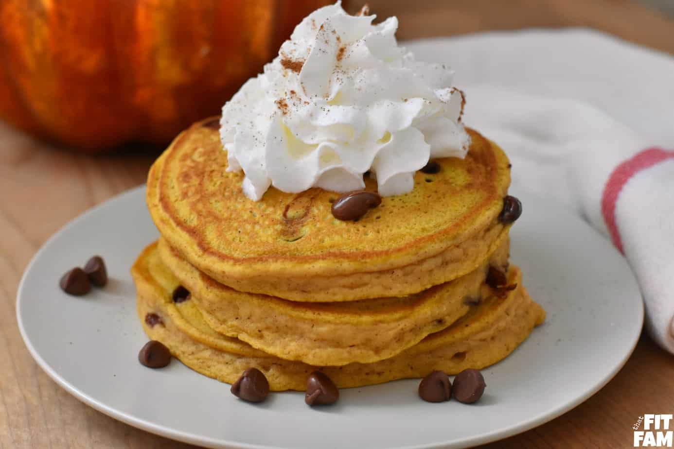 pumpkin pancakes topped with whipped cream & chocolate chips