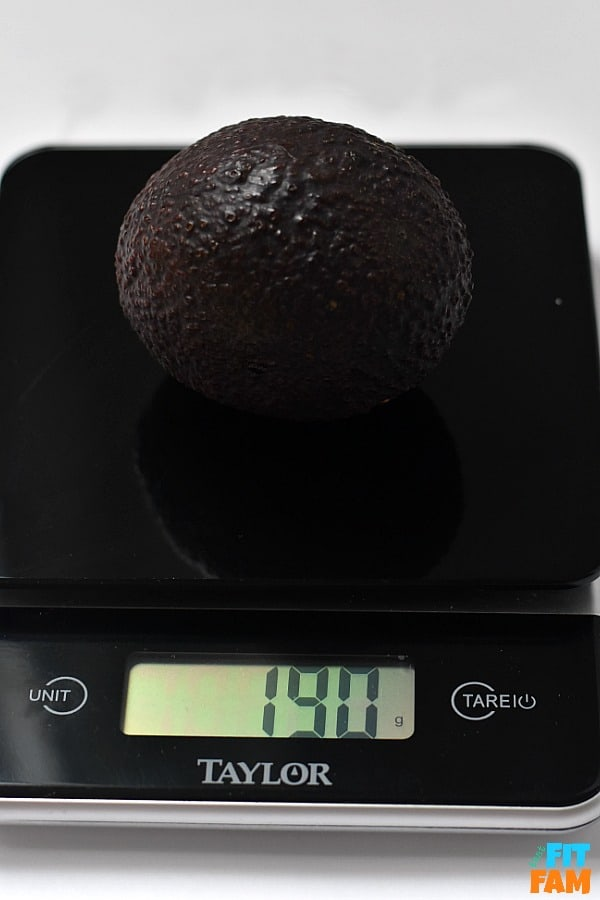 a whole avocado place on a food scale and measured in grams for accurate tracking