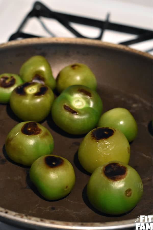 roasted tomatillos in a pan for tomatillo salsa