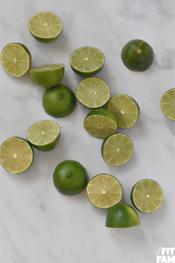 a bunch of cut up limes for making homemade limemade