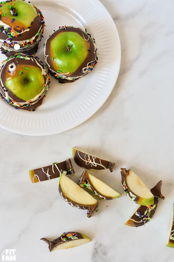 homemade gourmet caramel apples plated and cut up