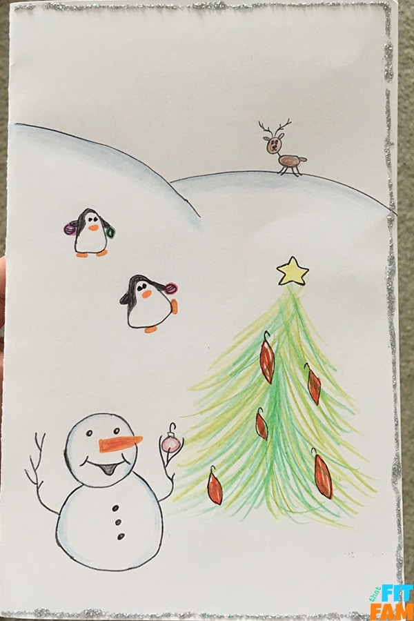 animals and snowman decorating Christmas tree in snow