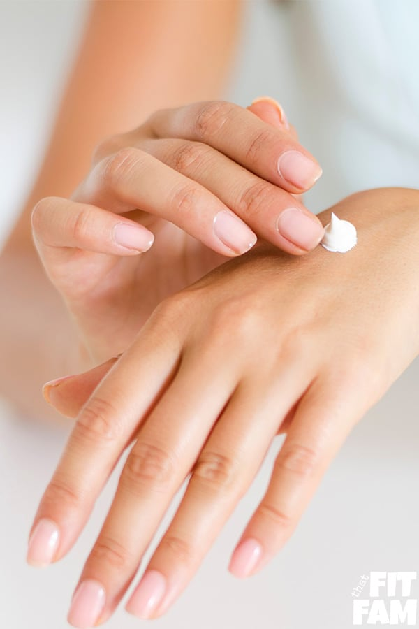 women putting lotion on hands