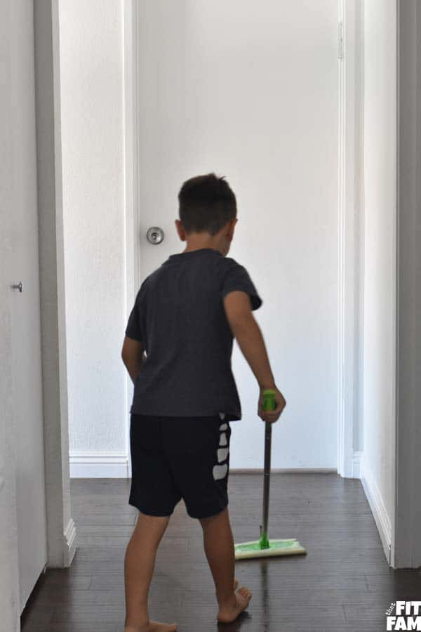 5 year old mopping the floor