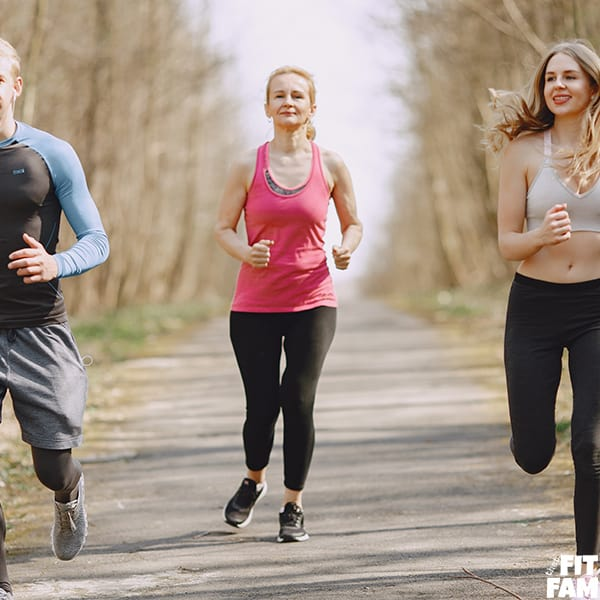 group of people jogging outside
