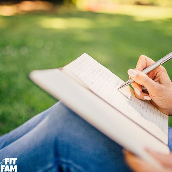 woman journaling at the park