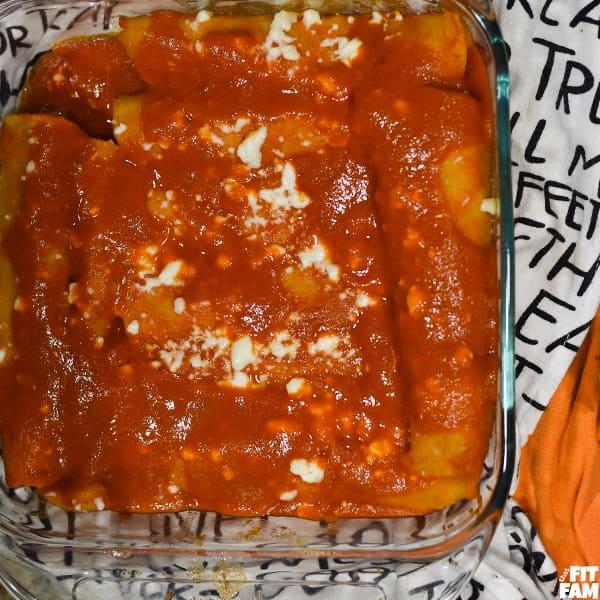 baking dish of red enchiladas